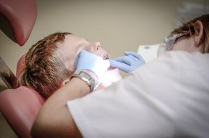 general dentist doing tooth extraction